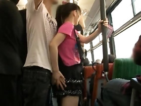 Cute Japanese Teen In Miniskirt Gives Handjob In Public Bus